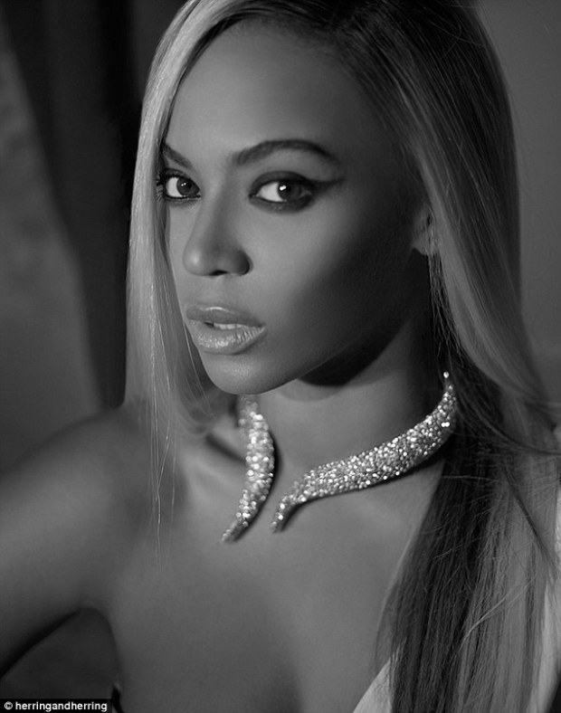 Diamonds are a girl's best friend: The September image of Beyonce shows her wearing just a sparkling choker contrasting with poker straight hair and cat's eye make-up