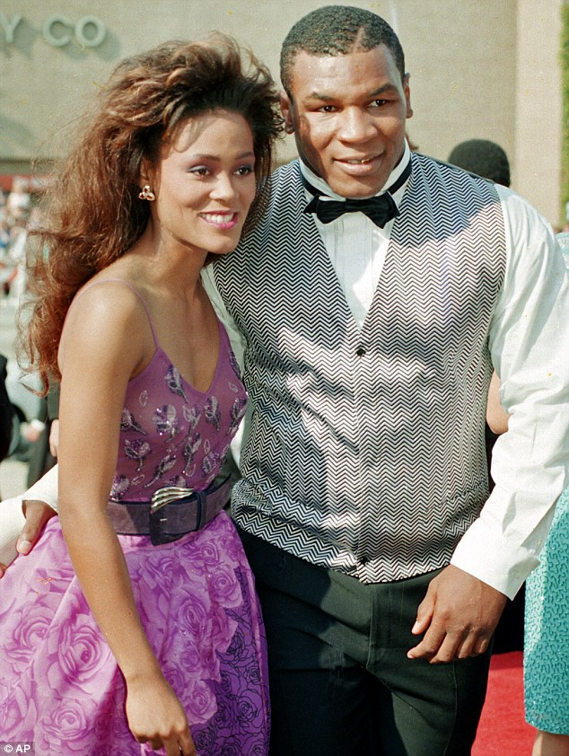Mike Tyson pictured with his ex wife Robin Givens in 1988 - he has spoken frankly about their marriage and branded her a manipulative shrew