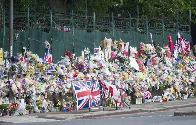 Grief: Flowers were left at the spot in Woolwich where Drummer Lee Rigby died on May 22 this year
