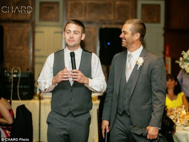 Brotherly love: Paul Walker and his youngest brother Cody, 25, give a toast at their brother Caleb's wedding to Stephanie Branch