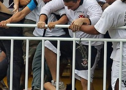 Crushed: An Atletico fan is trampled by Vasco de Gama supporters