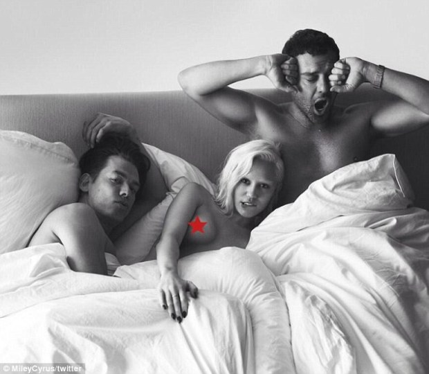 Provocative: Miley previously tweeted a censored picture of herself in bed with photographers Mert Alas and Marcus Piggott as part of the Bedtime Portraits series