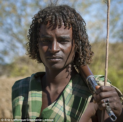 A cattle herder with a dayta hairstyle