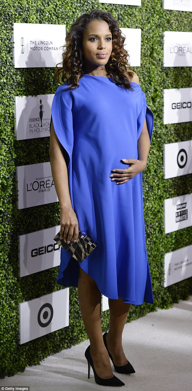 No hiding it kerry washington kept a hand to her belly while at the 7th