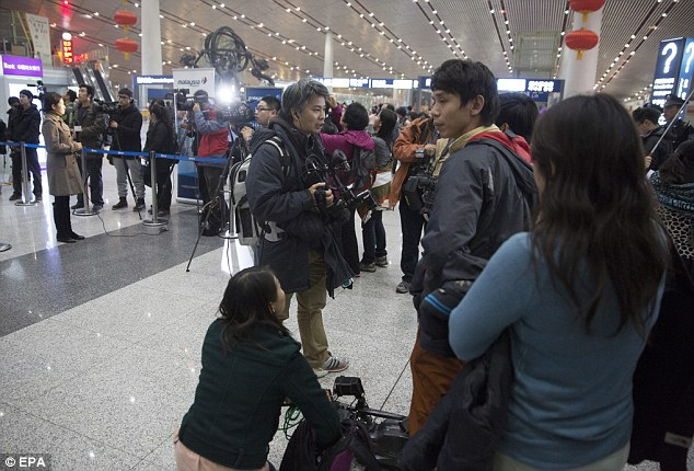 Chinese and international journalists wait at the check-in area for Malaysian Airlines at Capital Airport in Beijing, China on Monday