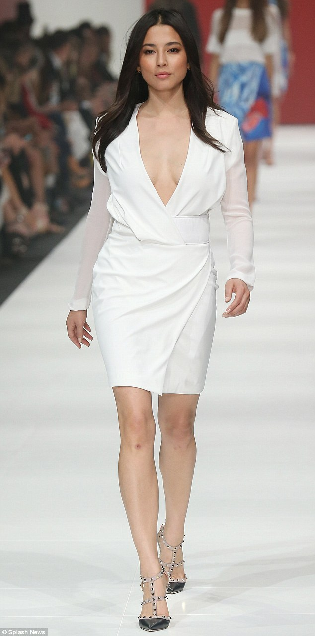 Alright in white: Jessica Gomes strutted the David Jones catwalk at Virgin Australia Melbourne Fashion Festival's opening night on Monday in a sizzling white Dion Lee dress