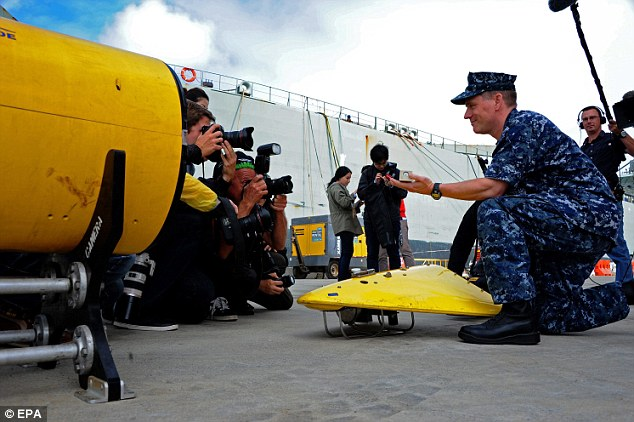 U.S. Navy Captain Mark Matthews with the pinger locator which has now reached the remote search area in the Indian Ocean where investigators hope it will pick up a signal from MH370's black boxes