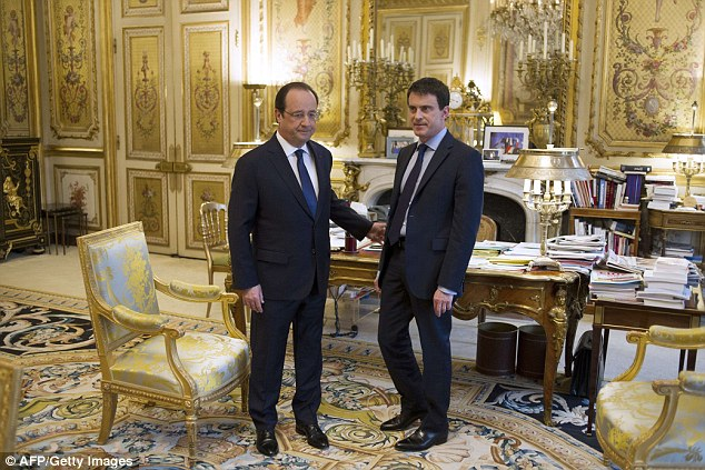 France's newly appointed Prime minister Manuel Valls (right) speaks with French President Francois Hollande before the first cabinet meeting of his government at the Elysee Palace in Paris