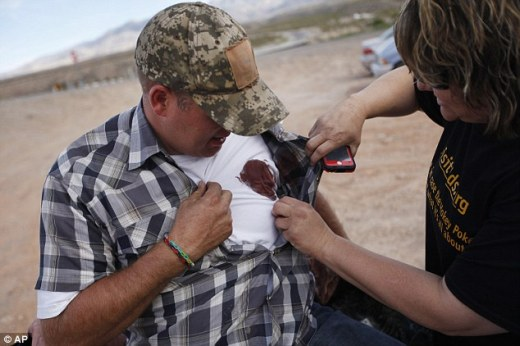 Bloodied: Krissy Thornton, right, looks at blood from a taser wound on Ammon Bundy