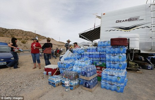 Dug in: Bottles of water and supplies sit ready to be used at a protest area on Friday