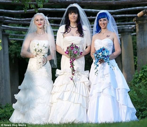 The 'married' lesbian threesome on their wedding day in August 2013
