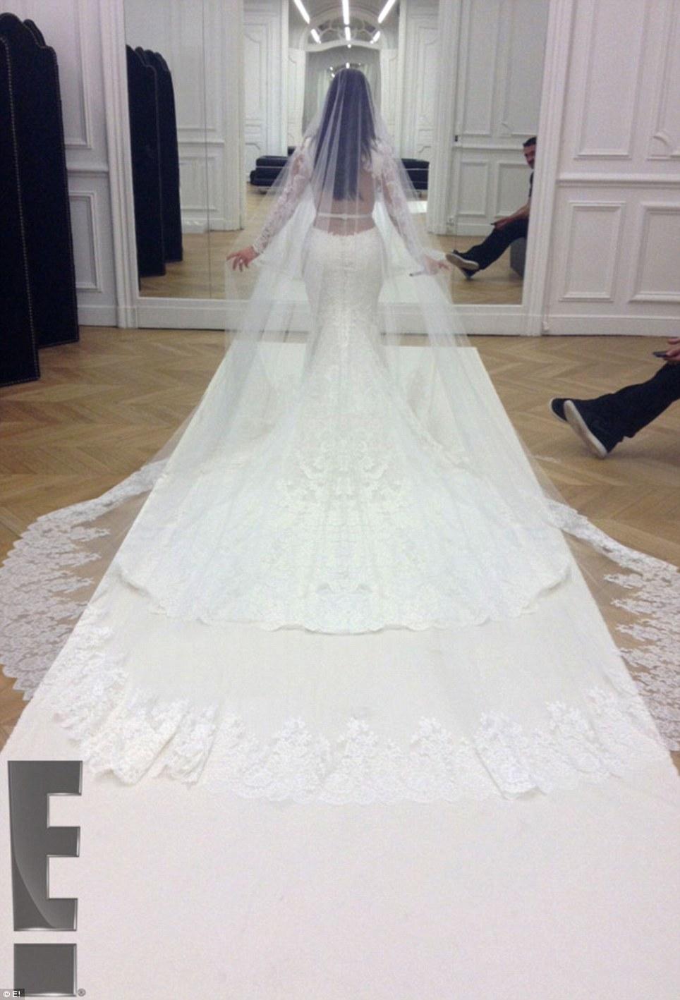 Kim Kardashian Kanye Wests lavish Italian wedding pictures revealed wedding dresses long train The BIG reveal Kim s backless dress was long sleeved with a train while