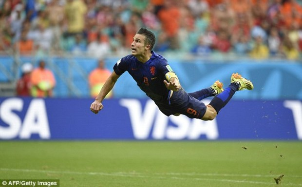 The flying Dutchman: Van Persie soars in the air as he equalises for Holland against Spain