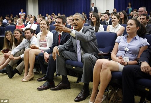 Buyer's Remorse: Americans say the country would be better off if Obama, pictured here yesterday watching the U.S. in the World Cup, had lost to businessman Mitt Romney in the 2012 presidential election