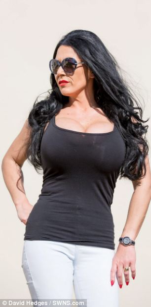 Debbie Delamar, 34, from Brecon, South Wales, who has Britain's biggest fake breasts