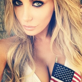 Feeling patriotic: Crystal Hefner planted the American flag in her cleavage at the Playboy Mansion 4th of July party