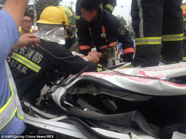 Rescue: Fire brigade spokesman Chi Tang said: 'We didn't expect anybody to be alive but then we heard a woman's voice and realised that actually somebody had survived'