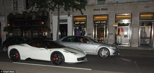 A fellow traveller marvels at a neighbouring white Ferrari. The unusual vehicles can prove quite a distraction