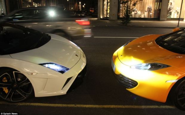 Two supercars have a 'face off' on the streets of London as they both bid to attract attention