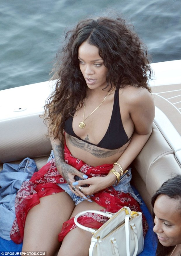 All aboard: Rihanna sure knows how to treat herself - and those around her - with the pop star taking to the high seas in stunning style in Sicily, Italy, on Wednesday