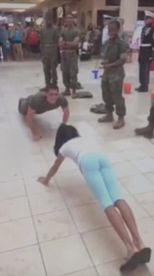 Little girl embarrasses burly US cadet by thrashing him in push-up