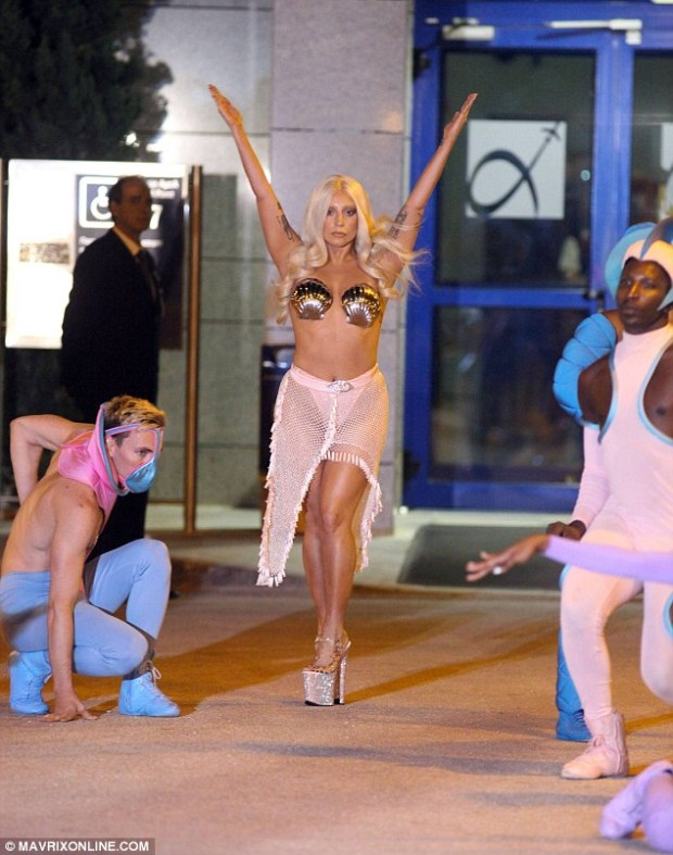 Dramatic arrival: Hours earlier, Gaga - born Stefani Germanotta - landed her private plane at Athens Airport where she and her dancers emerged in costume