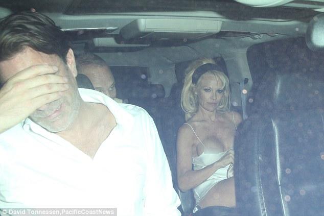 Pamela Anderson Suffers Wardrobe Malfunction As Her Dress