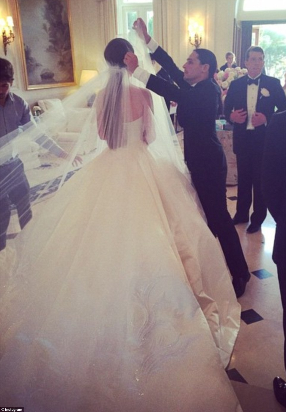 is spectacular wedding dress olivier theyskens designs cinderella gown ex barclay s chief s daughter nell south france extravaganza diamond wedding dresses Last minute Mr Theyskens is pictured adjusting Nell s veil in the moments before she walks