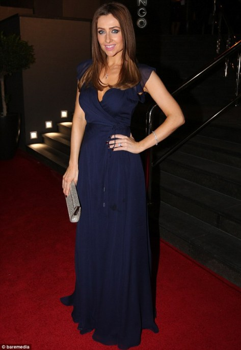 For the bash Gemma had opted for a much more demure look in the form of a long navy gown