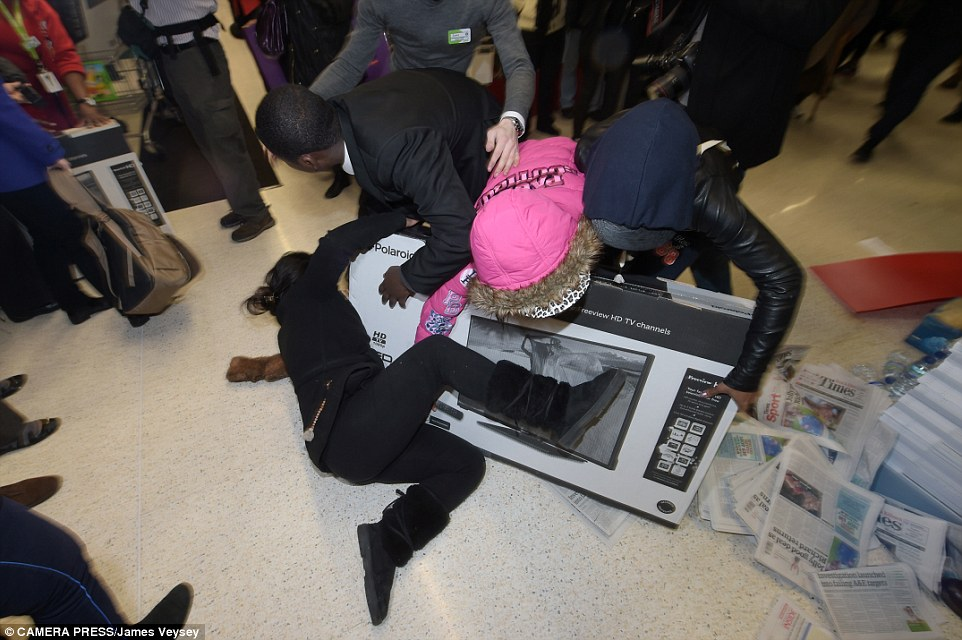 Black Friday turns violent as shoppers fight over bargains ...