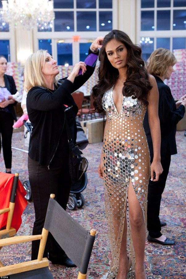 The Miss Universe contestants are touring, filming, rehearsing and preparing to compete for the Miss Universe 2014 crown to be decided on 25 January in Miami. Here,Miss Universe India, Noyonita Lodh, has her hair done by a stylist backstage