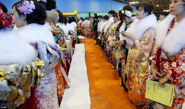 A Coming of Age ceremony at Tokyo's Toshimaen amusement park on Coming of Age Day