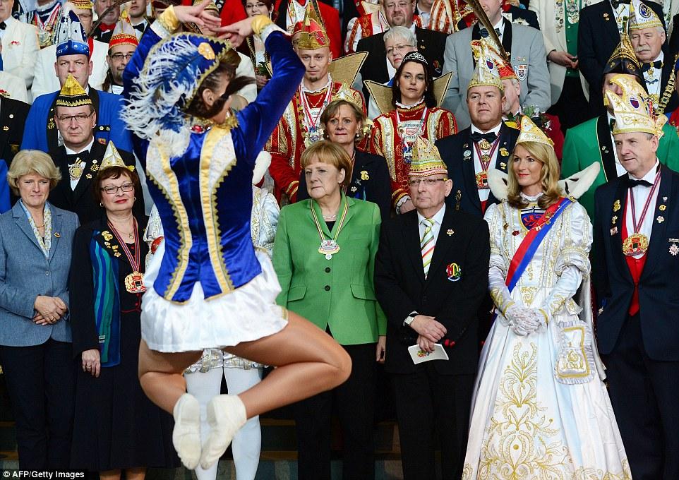 Angela Merkel Looks Away As Female Dancers Perform The