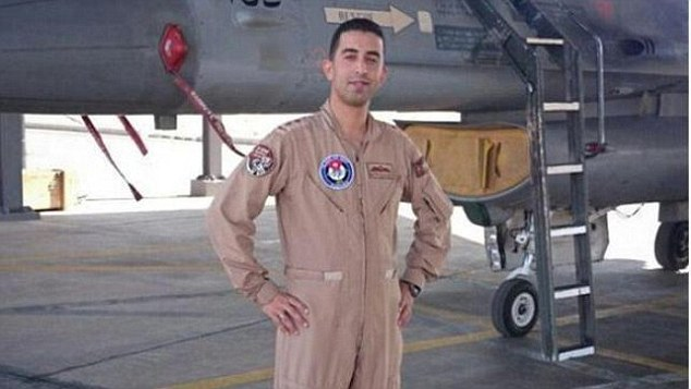 Clean cut: 26-year-old Moaz al-Kasasbeh is seen wearing his pilot's uniform before being captured by ISIS