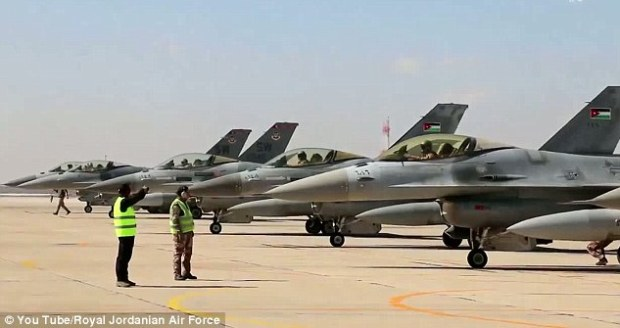 Show of force: A fleet of Jordanian F-16 fighter jets are lined up at a base ahead of air strikes in Syria and Iraq