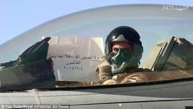 The video also features a pilot holding up a sign that reads: 'And do not think that God is unaware of what the evildoers are doing' - an apparent warning to ISIS militants. The message is based on a passage in the Quran