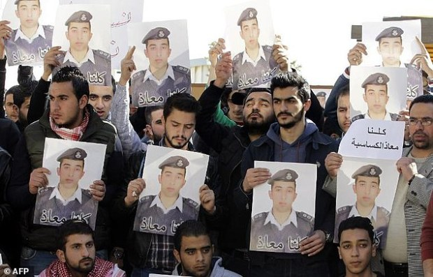 Activists carry pictures of Jordanian pilot Moaz al-Kassasbeh in Amman earlier this week