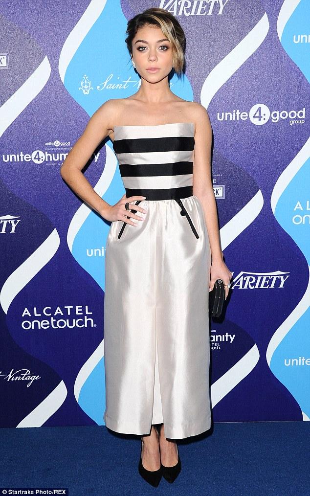 Sarah Hyland looks effortlessly elegant in sweeping silver gown as