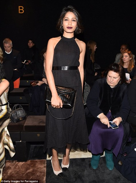 Freida stood tall in a pair of monochrome heels, while she toted her belongings in a classic leather clutch bag