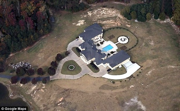 Estate: The only way to appreciate the scale of Rev Creflo Dollar's home is from the air. The house is set in 56 acres, including grass and woodlands