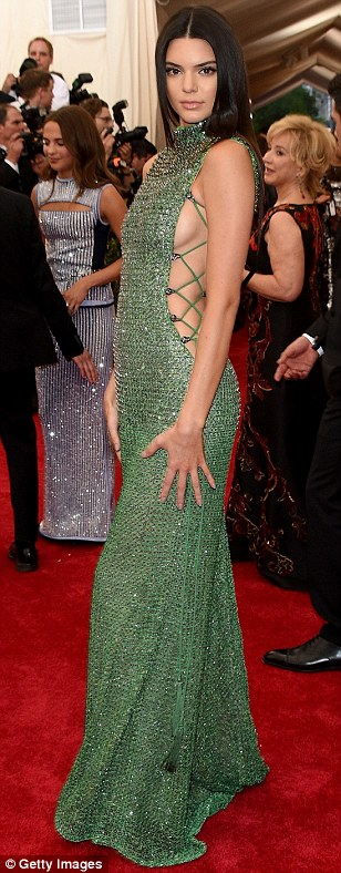 Ooh la la: Kendall Jenner skipped the theme in favour of a very racy green Calvin Klein number, leaving lots of sideboob on show