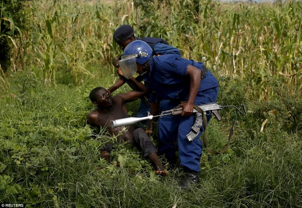 A policeman detains a protester during a protest in Buterere neighbourhood of Bujumbura yesterday afternoon