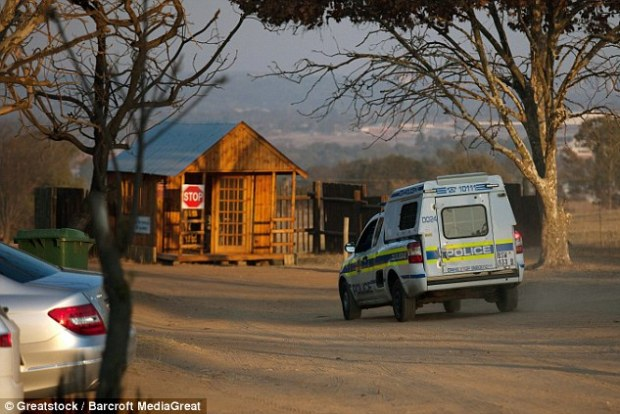 A police van arrives at the Lion Park where an American tourist was killed by a lioness on June 1