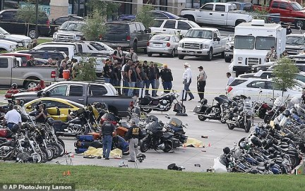 Aftermath: Law enforcement officers are pictured on the day of the Waco, Texas, biker shootout speaking to more than a dozen gang members and sifting through evidence at the site of the gun battle which left nine dead