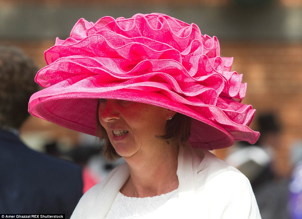 Racegoers In Feathered Visors And Butterfly Hats Get Royal