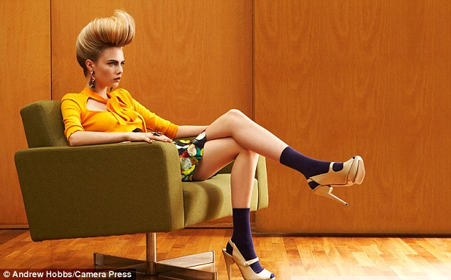 Hair-raising: Cara models a range of gravity-defying hairdos in the glamorous images