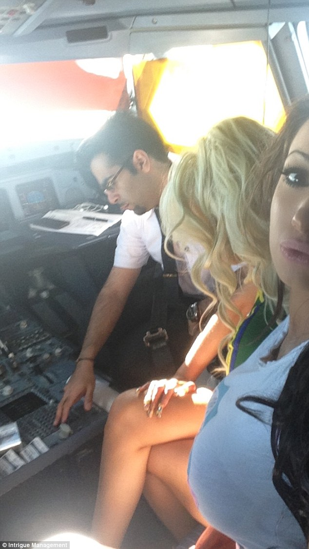 Sensational claim: X Factor reject Ms Mafia, real name Chloe Khan, has claimed the Kuwait Airways pilot asked her to call him 'naughty' (the plane's co-pilot is pictured)