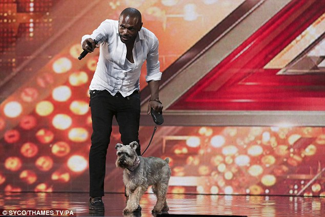 Showing his support: Anton is all-clear after a six-year battle with cancer, and seemed to have brought along his pooch to auditions for extra support