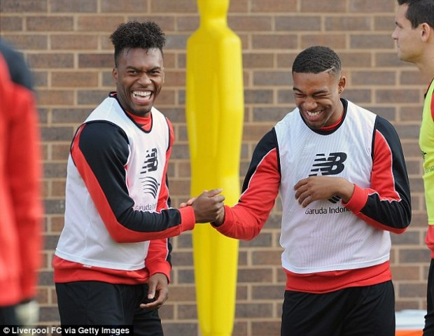 Ibe (right) jokes with Daniel Sturridge during a Liverpool training session last week