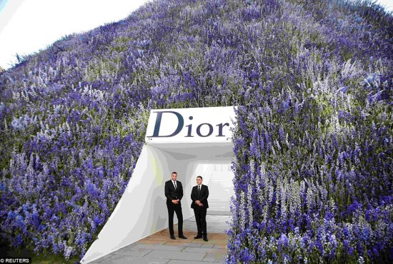 Ready and waiting: Body guards manned the entrance to the stunning flowered dome as the show got ready to kick off